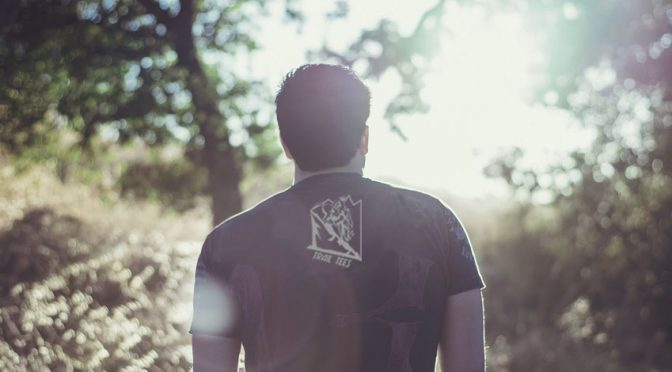 T-shirt on a guy looking at nature